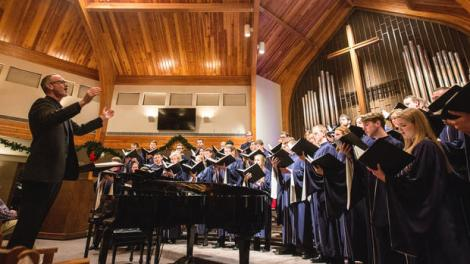 Benjamin Kornelis, left, director of the Dordt College Choir leads the ensemble in a hymn during the Dordt College Choir winter tour at the First Presbyterian Church in Grand Forks, ND on Wednesday, January 4, 2017. (Joshua Komer / Grand Forks Herald)