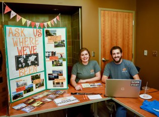 Art&Entertainment.SWB Coffee&Off-CampusFair Representatives for the CCCU table smile at the off-campus fair